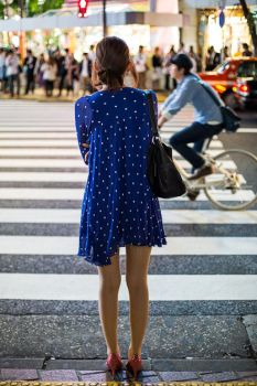 Lone girl at Shibuya crossing by guffy