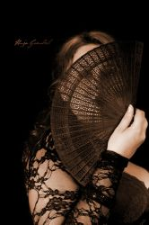 Behind the fan by SymphonicA19