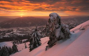 Dramatic fiery sunset in winter Carpathians by Sergey-Ryzhkov