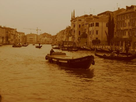 boat on canal in italy by black-martin
