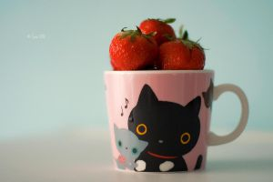 Cup of strawberries by Lain-AwakeAtNight
