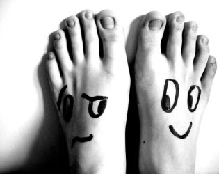 Feet with faces by ThinkFrog