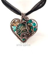 Teal and gold steampunk heart by ukapala