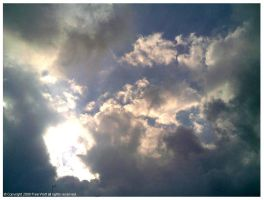 Sun Rays through Cloudy Sky by thefreewolf