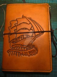 Leather cover for a Travellers Journal by LeathercraftersInn