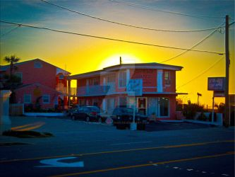 Small Motel On The Beach At Sunrise by BlakeHenryRobson