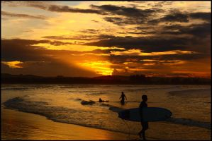 Surfing Byron's sunset 2 by wildplaces