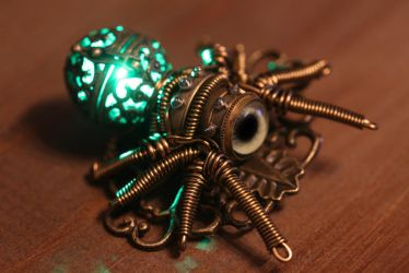 My newest creation ... a glowing spider brooch. by CatherinetteRings