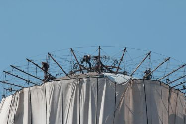Workers on top of a water tower by Ankh-Infinitus