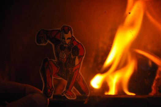Iron Man in flames by DontTouchMyLlama