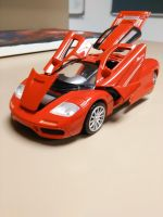 Red Mclaren F1 (Diecast) by Amgnismo
