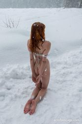 Greta tied up in the snow by alexkimi