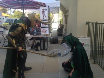 Doom Kneeling Before Loki by Shenanigans4321