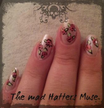 Nail art: First flowers. by TheMadHattersMuse