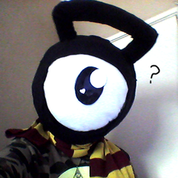 Fursuit head on! (Photo taken with a shoe :P) by GluryTheUnown
