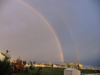 front yard double rainbow by sataikasia