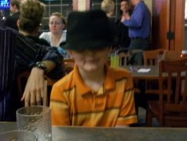 my cusin with my brothers hat 1 by Daddys-Girl1997