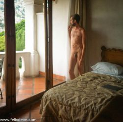 Taxco Hotel standing male nude leaning on window by TheMaleNudeStock