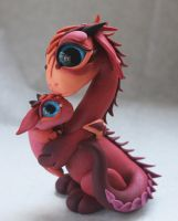 Mamma and Baby Dragon by BittyBiteyOnes