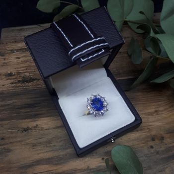 18ct Gold Oval Blue Sapphire Diamond Cluster Ring  by campbelljewellers