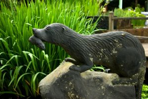 Otter with fish statue by steppelandstock