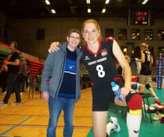 Tall Volleyball player kneel by lowerrider