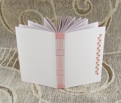 pink stitches, lined journal by yatsu