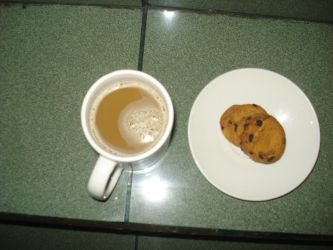 Choco chips cookies and a cup of white coffee by rezatanaka