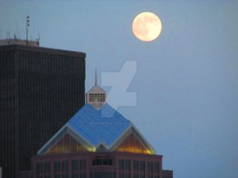 Moonrise over the city 2 by unchained-melodee