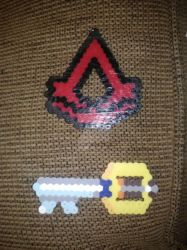 Keyblade and Assassin Creed keychain by worldwanderer