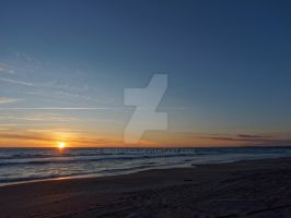 Sunset at Whanganui Beach by Deceptico