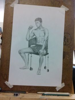 Man Sitting on a Chair by UpcoRaul