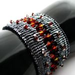 Fire and Ashes bead loomed cuff by CatsWire