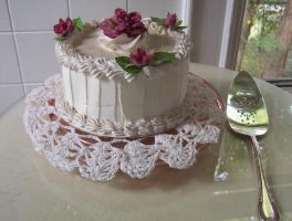 White cake with flowers on top by caspercrafts