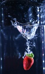 Strawberry Fall into water fast shutter photo by BlacksmithOWY