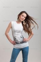 Young Girl Posing in White T-shirt on Grey Backgro by Ondrejvasak