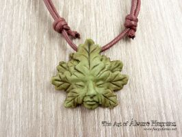 Greenman resin pendants by AlvaroFuegoFatuo