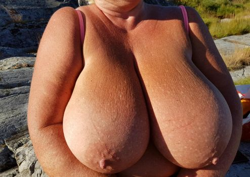 Suntanning my boulders. by Cleavage3