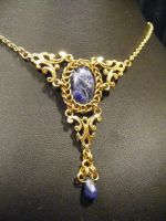 framed persian sodalite in gold necklace by BacktoEarthCreations