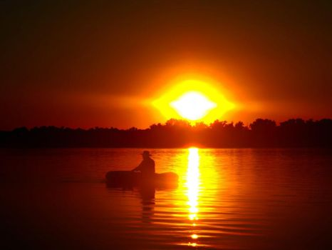 Old man in boat going into sunset by Enya-kun
