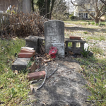 Propped up headstone by NickACJones
