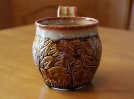 Ceramic Brown and Beige Tree Themed Mug by pixelboundstudios