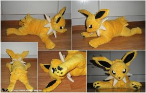 Laying Jolteon plush by Tedimo