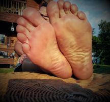 relaxing my feet in the evening sun by Netsrot1971