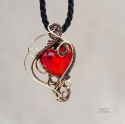 Red heart wire wrapped pendant by IanirasArtifacts