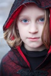 hooded child stock by twigstock