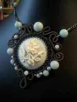 Coiled poppy cameo with amazonite by BacktoEarthCreations