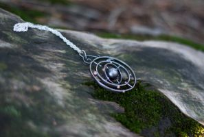Spinning Silver Solar System with Gold Planets by MirielDesign