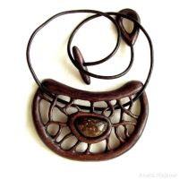 Openwork wooden pendant with amber 1661 by AmberSculpture