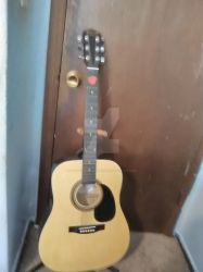 My Johnson acoustic guitar by amoticanime